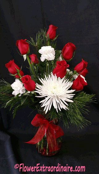 elegant floral arrangement of red roses, white carnations, and evergreen sprigs