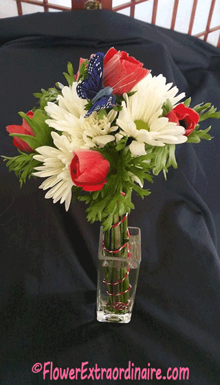red tulips white daisies blue butterfly flowers in vase