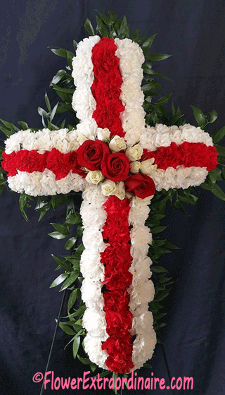 red and white cross made from flowers